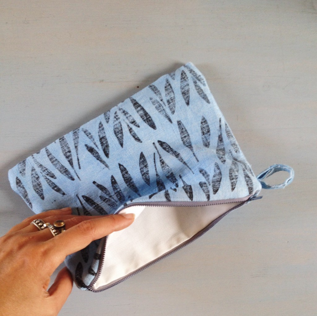 medium light indigo zipper pouch with seed pod print